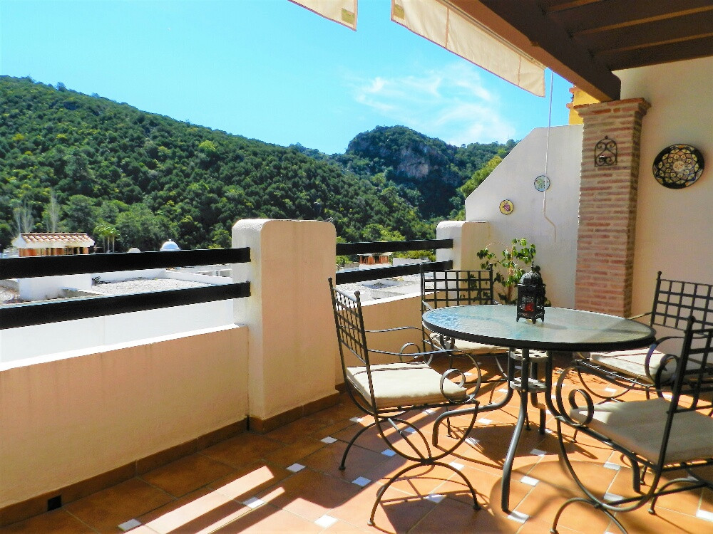 Immaculate townhouse located in the very popular village of Benahavis, in a gated community .  The p,Spain
