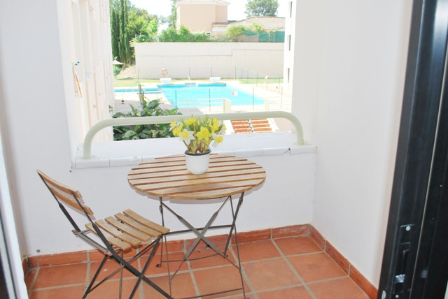 Large studio with separate kitchen and garage in complex with pool and green areas. Near  the most e, Spain