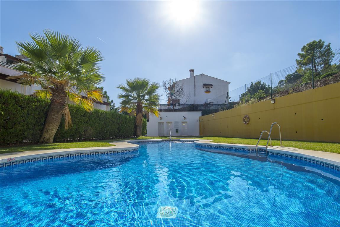 Immaculately presented townhouse with 2 bed 3 bath, on two levels, with sunroof terrace and basement,Spain