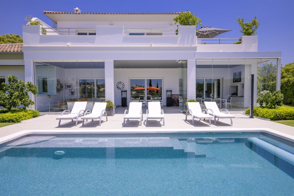 Located in a lovely corner of the exclusive Santa Maria golf course in Elviria, this elegant villa h, Spain