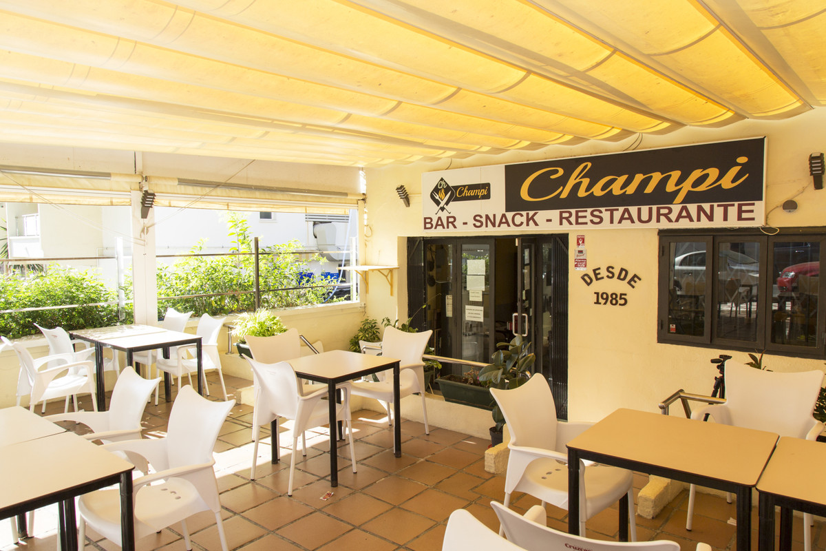 The Champi restaurant is located in the famous neighborhood of La Carihuela, a few meters from the b,Spain