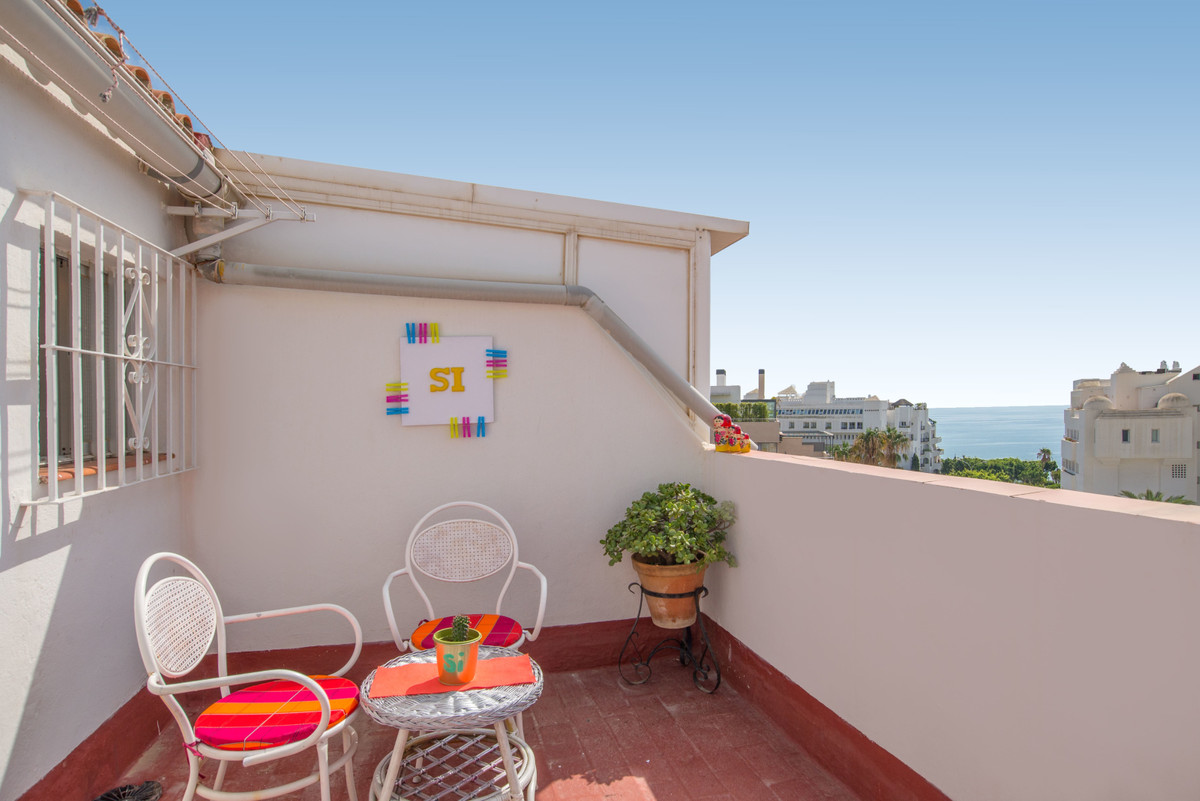 """""""Casa Sora"""" is located in the commercial area just 5 minutes from the beach of Bajondillo, with the bus stop at the door, near schools, the taxi stop, the commuter train Nogalera, restaurants and from the famous San Miguel Street. This beautiful apartment is located in a quiet urbanization with communal pool and outside garage space. It consists of three floors in the first we have the kitchen-separate laundry room and a spacious living room with terrace and southeast views of the sea and the avenue. In the second we have two bedrooms and a bathroom and in the third, the third bedroom, a full vintage bathroom and a nice roof terrace facing south and clear views of the Mediterranean."""