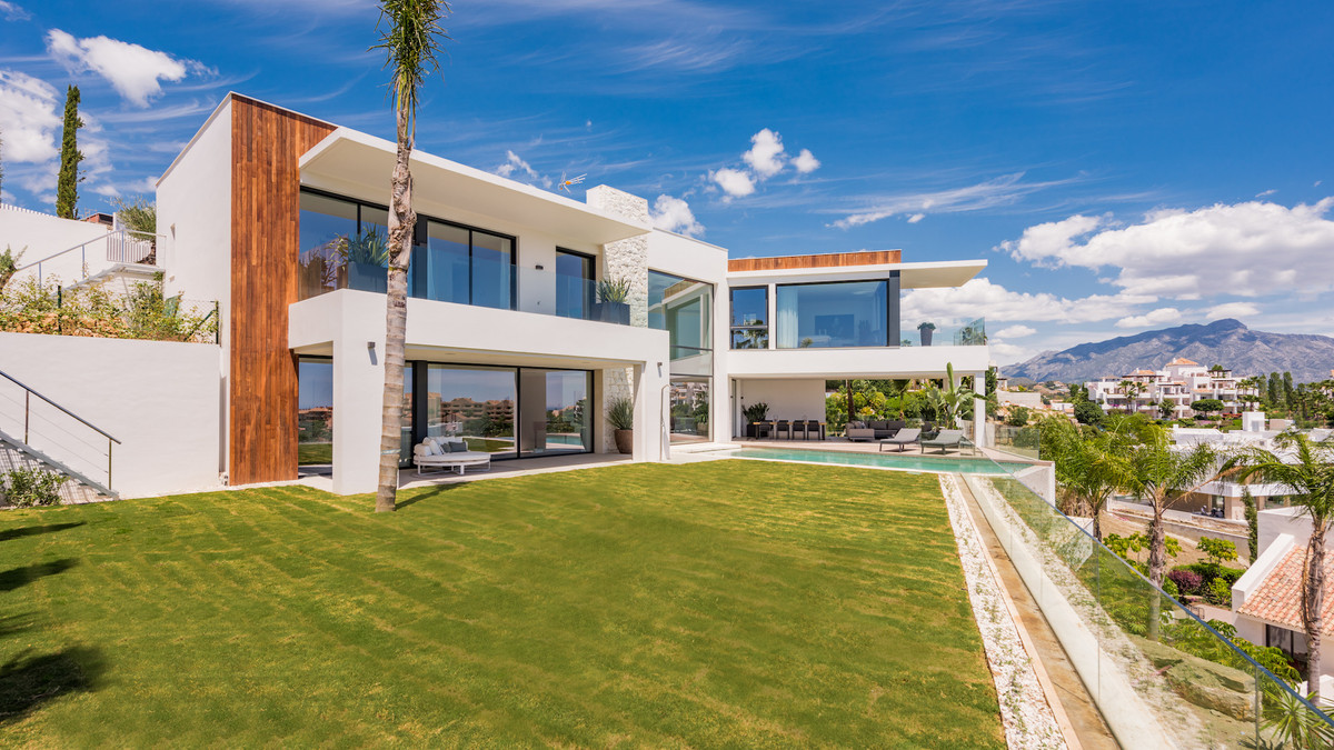 This contemporary and modern villa is finished with wooden facade cladding and natural stone element,Spain