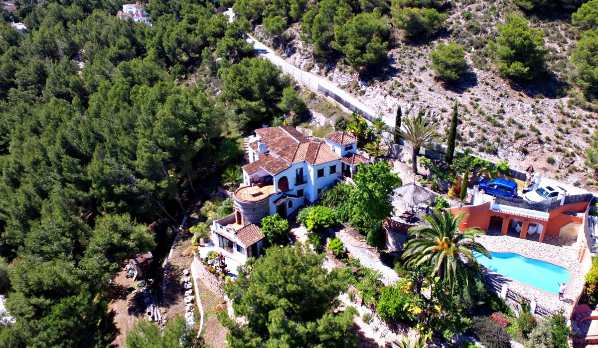 Just outside the gates of the white village of Frigiliana is this 200m2 villa with separate guest st,Spain