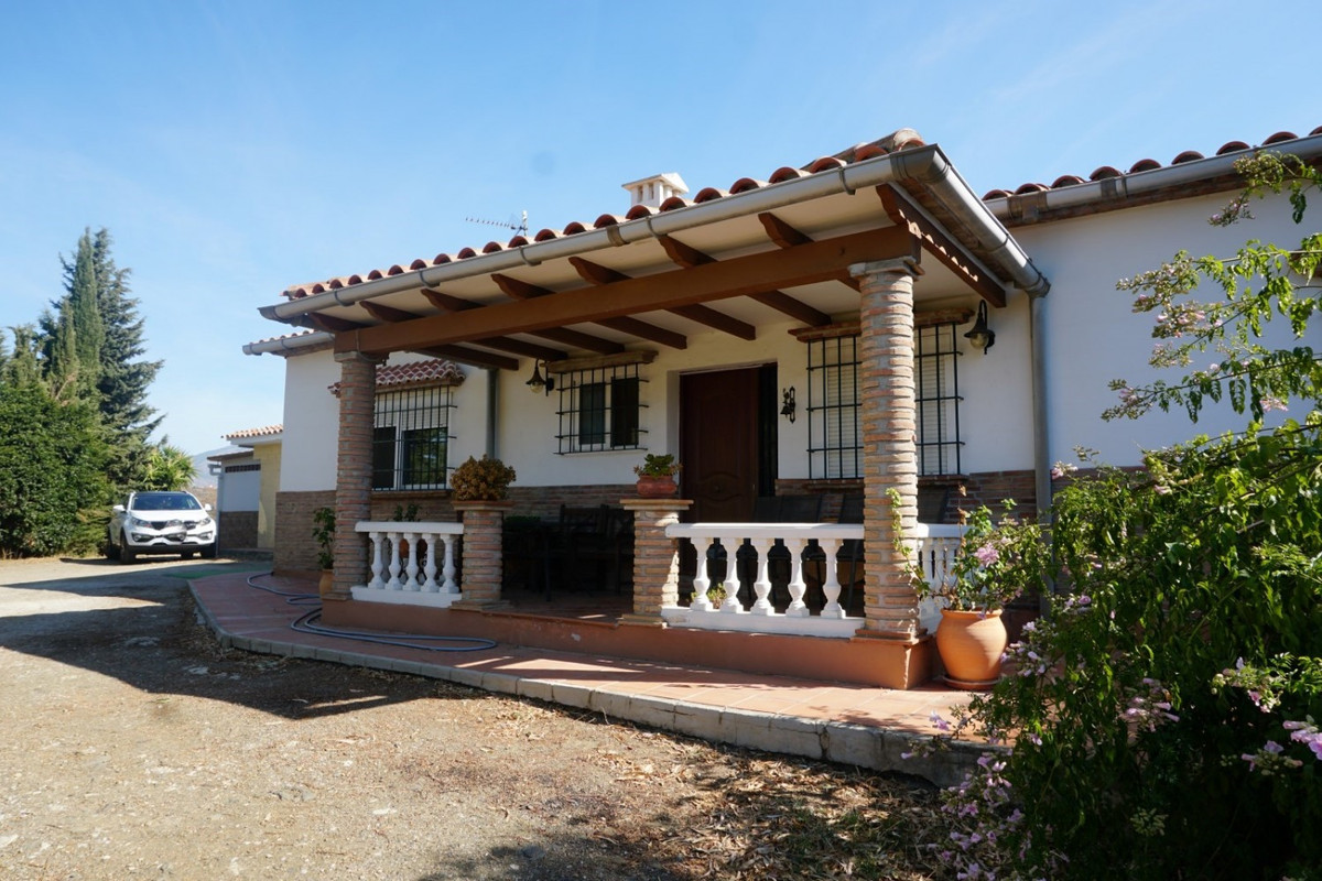 Just five minutes from Velez-Malaga and two from the town of Benamocarra is this beautiful property.,Spain