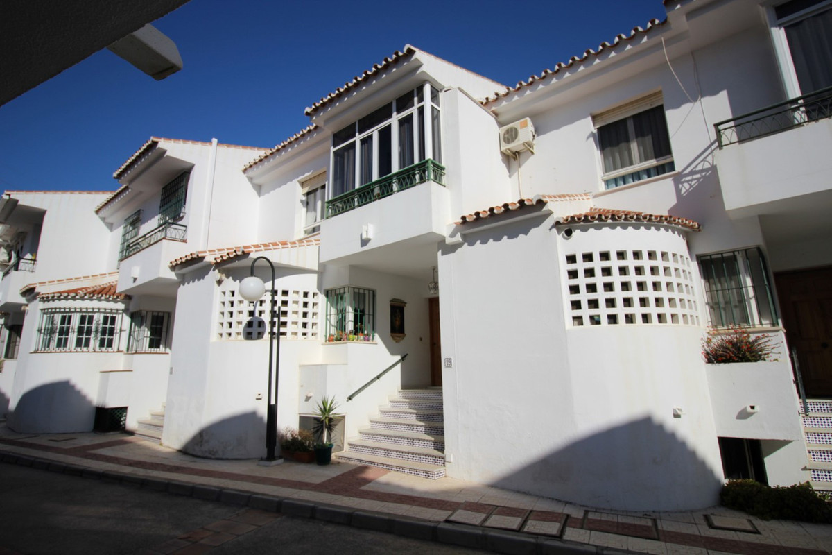 Beautiful townhouse in La Caleta de Velez with a spacious living room with fireplace and access to a,Spain