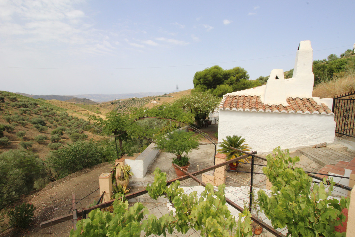 Farmhouse with land of 18.000 m2 in Canillas de Aceituno.  The property features lounge-dining room ,Spain