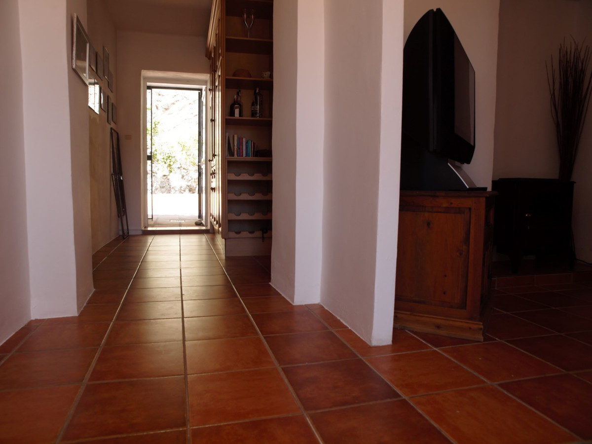 Refurbished House one step from the Beach in Torrox Costa.  This house with orientation south to the,Spain