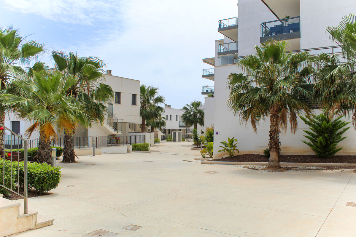 Ground floor apartment for sale in a residential complex with a large communal swimming pool in Orih, Spain