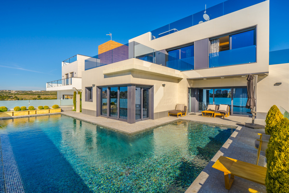 Stylish, sunlit villa is located in Campoamor, Orihuela Costa. This town is an excellent choice for ,Spain