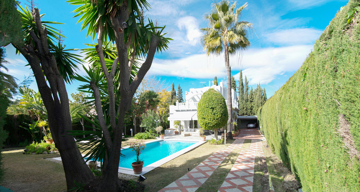 Las Brisas villa with Andalusian architecture and Moorish flare offers comfortable living  within wa,Spain