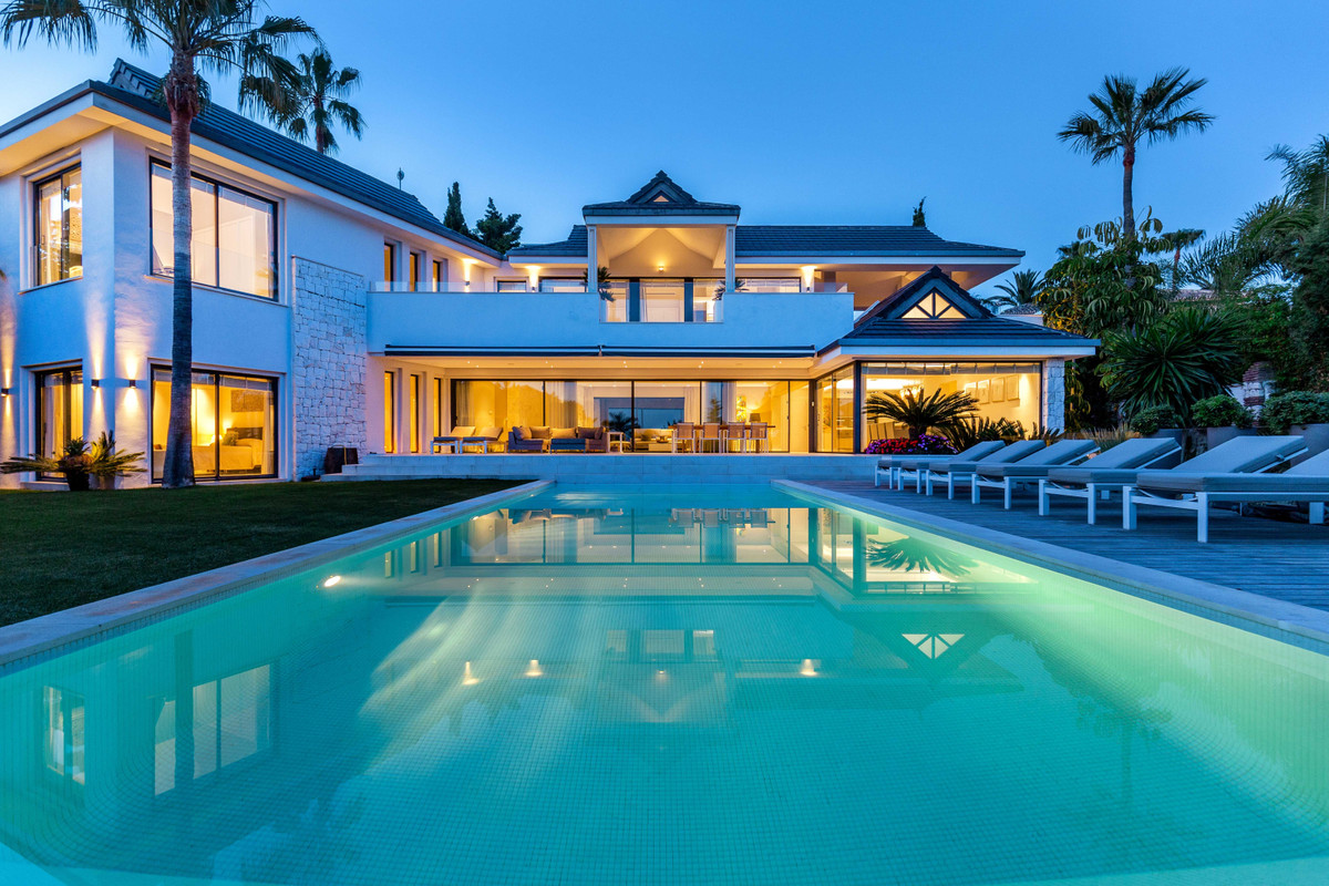 A stunning, beachside, luxury villa  ideally positioned and set within one of the Marbella's moSpain