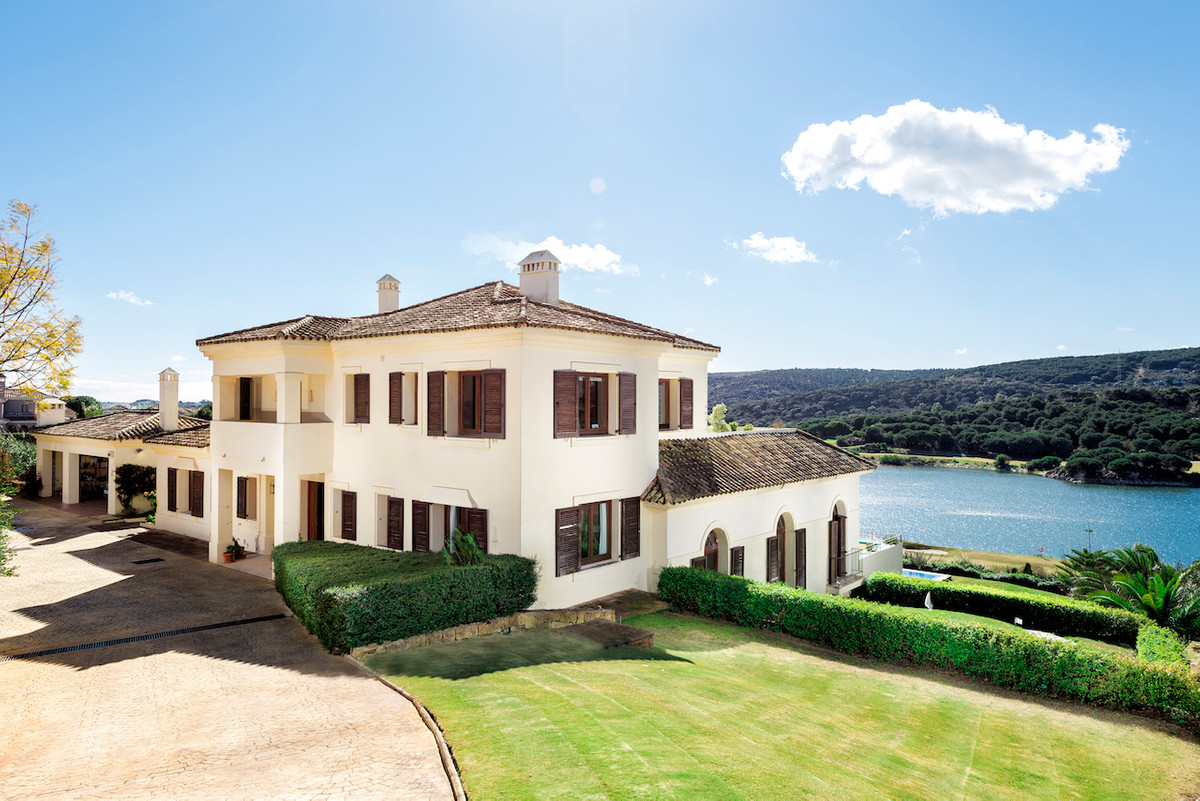 This exclusive villa is set in an enchanting position with magnificent views over the lakes on the b,Spain