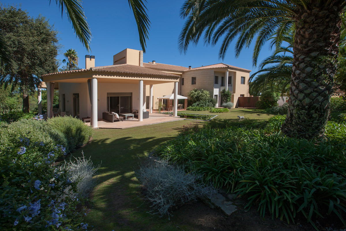 This unique home is situated in a quiet cul-de-sac in the Sotogrande Costa area.      The accommodat, Spain