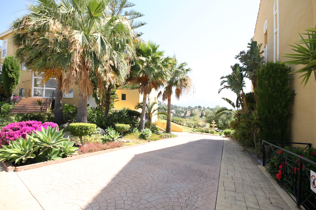 This inviting apartment has been well maintained and is located within a gated complex in an up and ,Spain