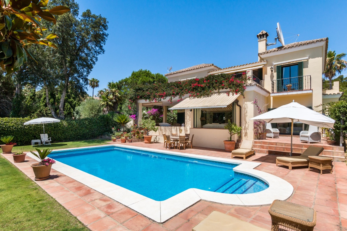 This beautifully presented south facing villa has the accommodation spread over two floors.  This vi,Spain