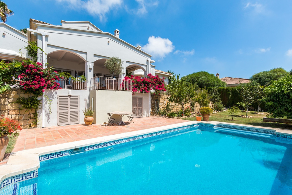 This charming traditional style family villa is located in a quiet street in the popular area known ,Spain