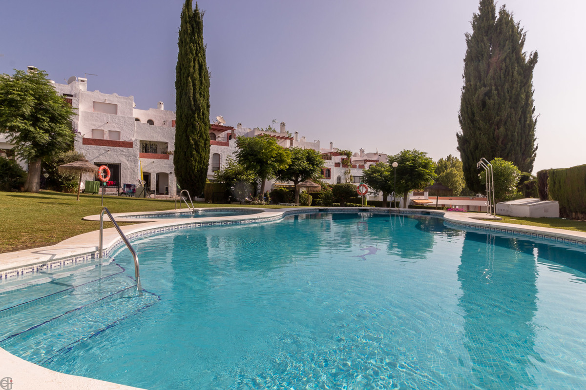 Spacious corner house with private garden, garage and sea views  This fantastic property is distribu,Spain