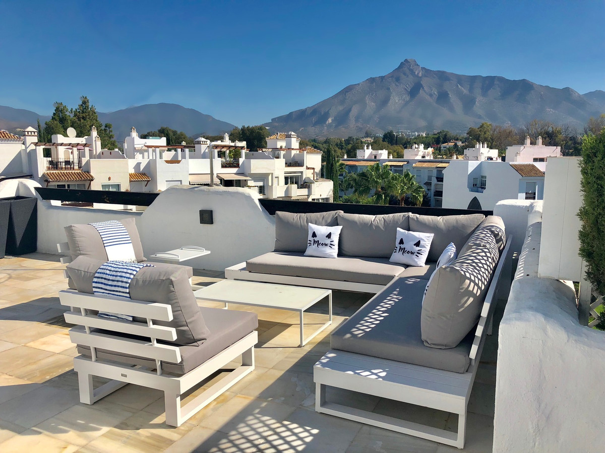 A very spacial penthouse apartment built on two levels and offering fantastic mountain, pool, garden,Spain