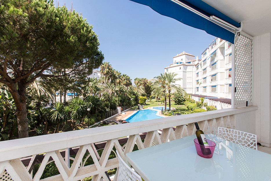 Superb south facing apartment offering garden and pool views in a 5 star complex in the heart of Pue, Spain