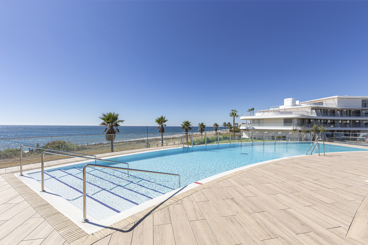 Ground floor with three bedrooms, private garden, parking space and store room in Estepona West.  Lu,Spain