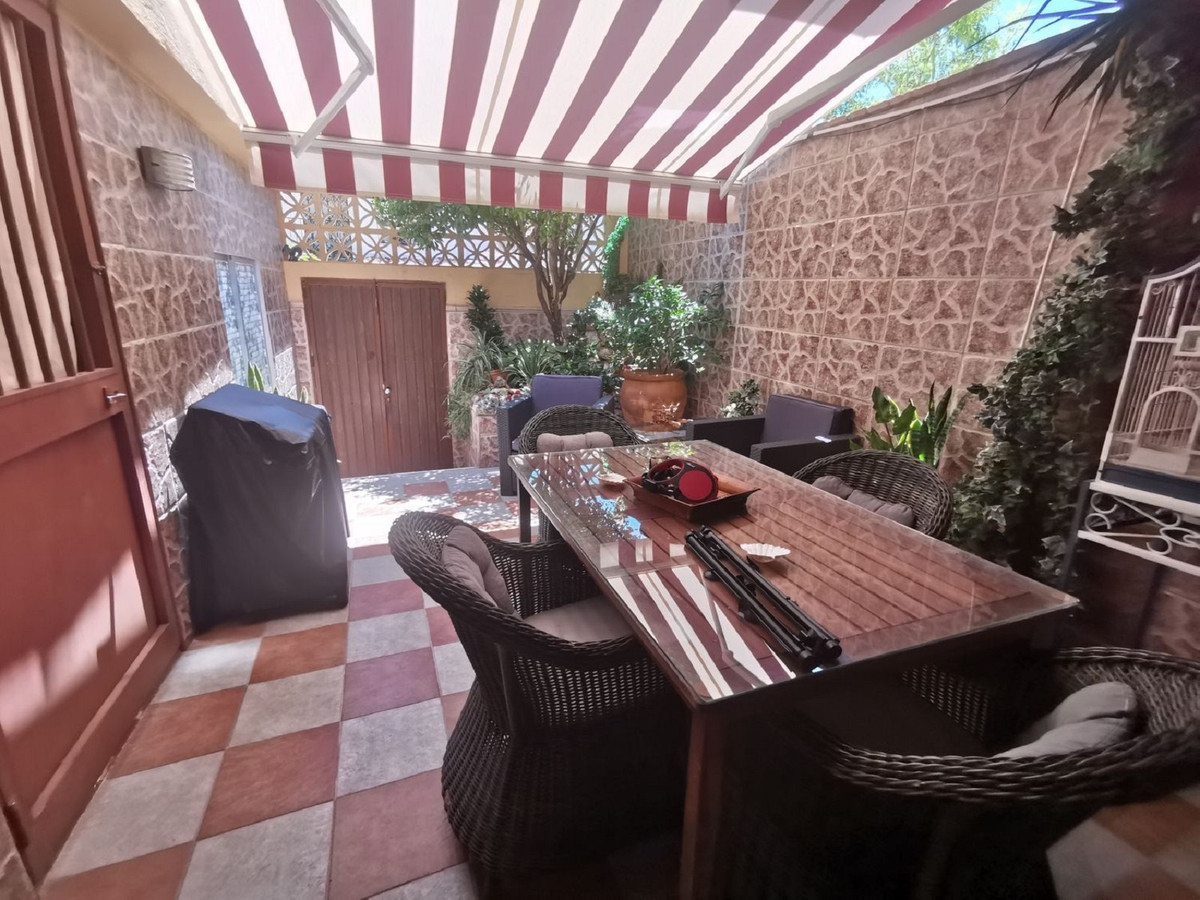 Beautiful corner townhouse with three floors. Basement has a garage for two cars, two bedrooms and a, Spain