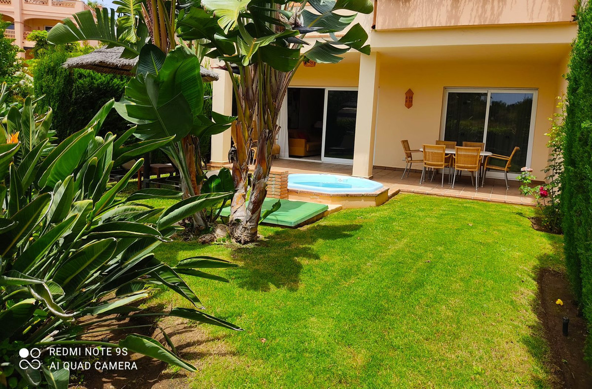 Beautiful ground floor apartment with private garden and views of the common areas with swimming pooSpain