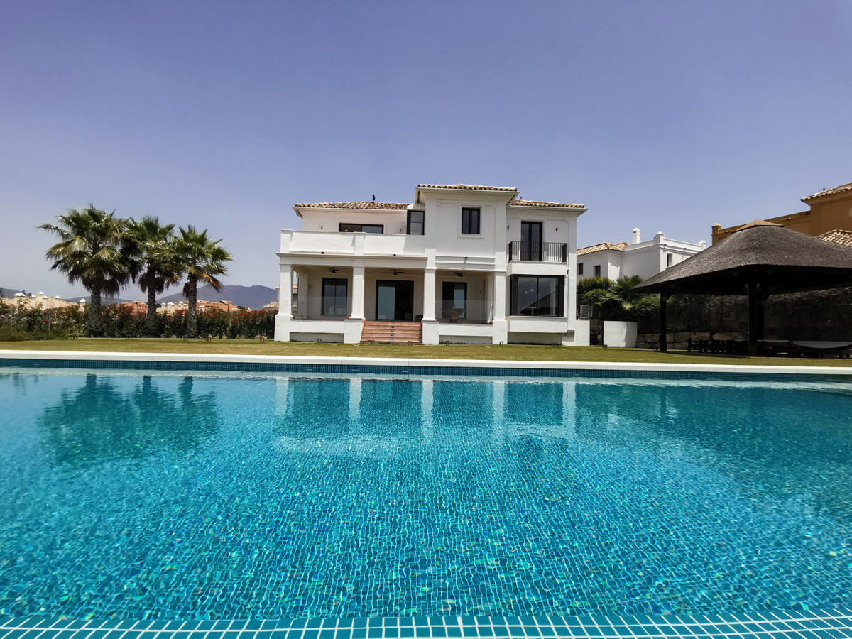This is a stunning villa on a double plot with a fabulous infinity pool and amazing views of the Med, Spain