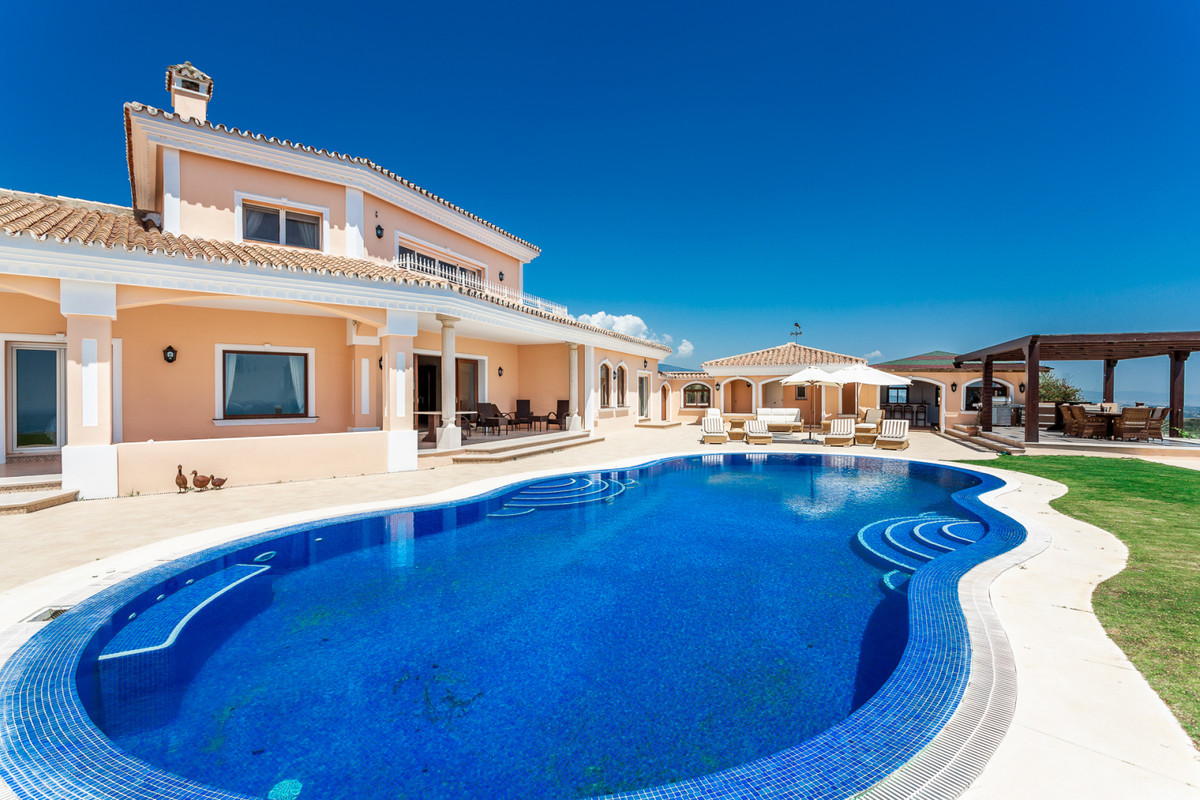 HILL-SIDE RURAL HOUSE IN ESTEPONA  At the entrance to this impressive mansion you will be greeted by,Spain