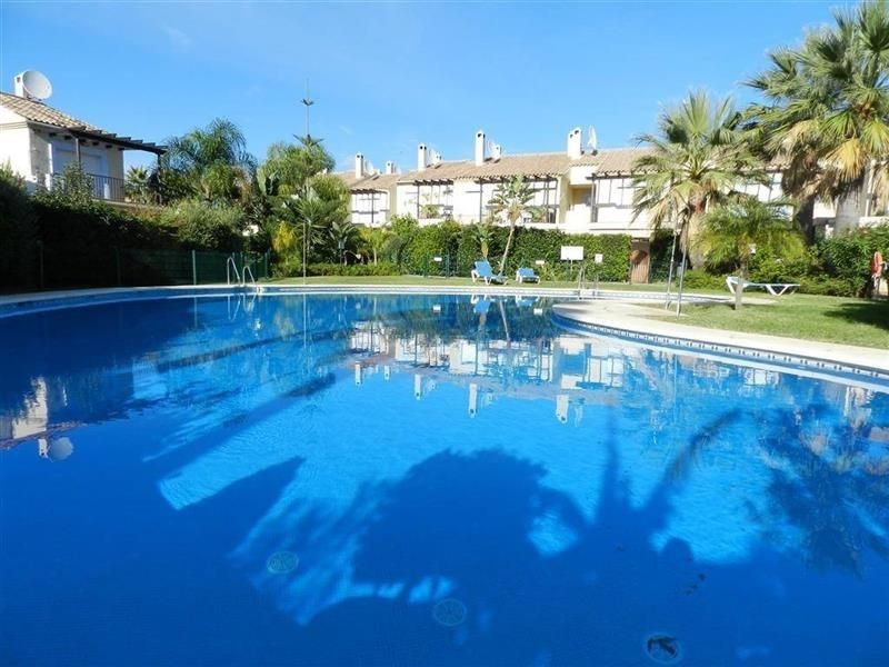 This townhouse style property is built on two floors within a private gated community of 74 houses. ,Spain