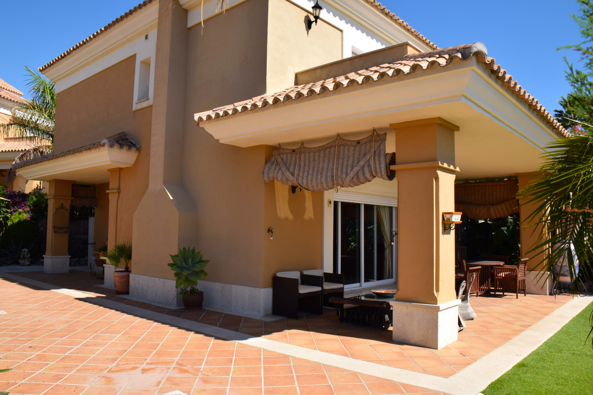 Beautiful semi-detached villa with south facing and good views. The property is situated in an exclu, Spain