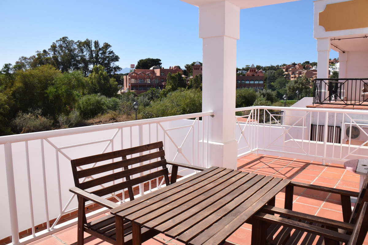 Nice and spacious townhouse located in Artola very close to the golf course. The property is divided,Spain