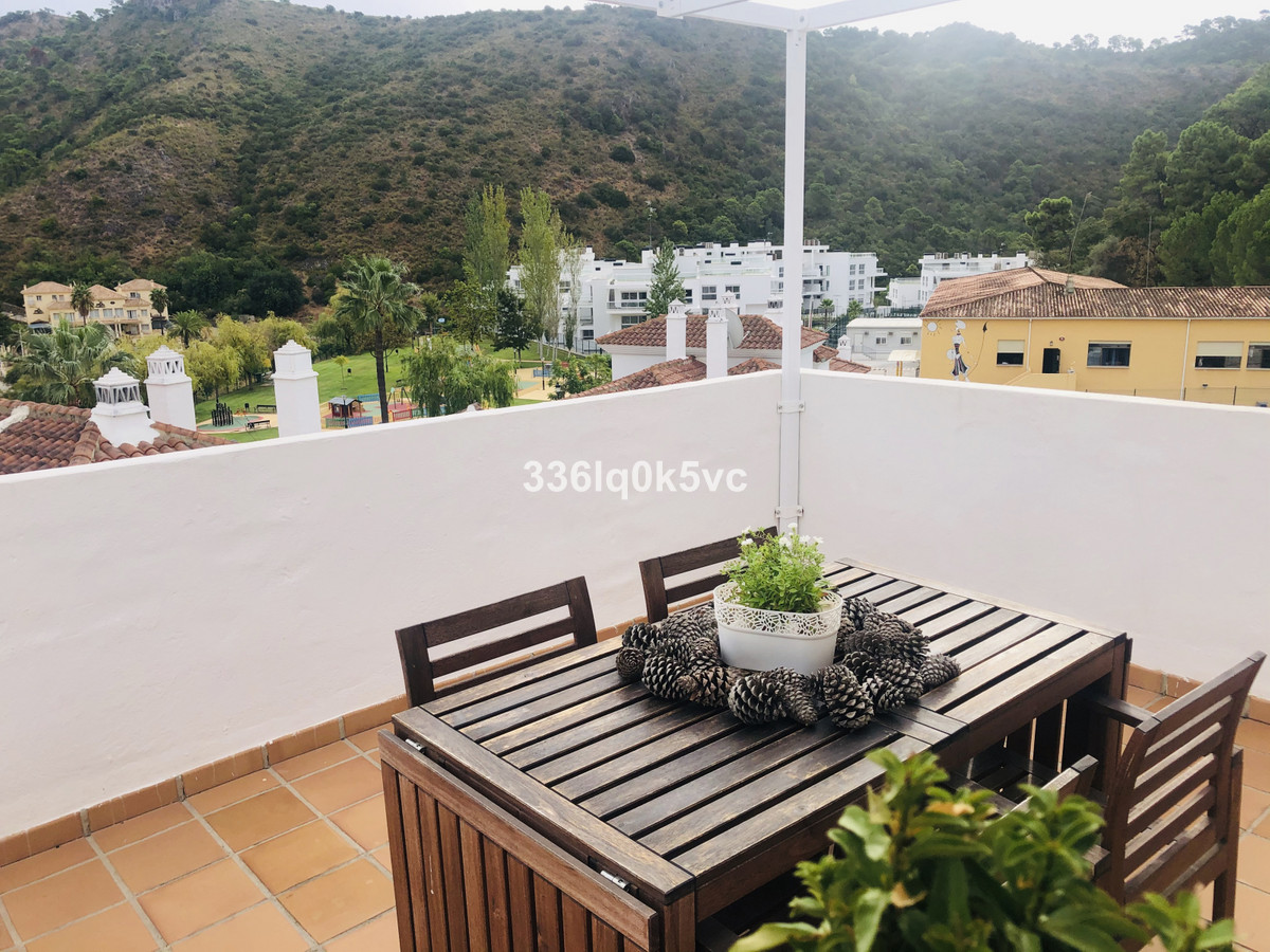 Penthouse in Benahavis village with 2 bedrooms and bathrooms. Living room with open kitchen. Large t,Spain