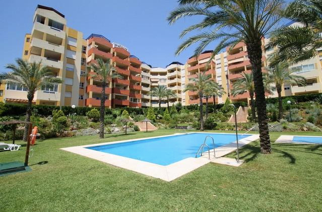 Spacious apartment is located in the sought after urbanization Green Mar, Atalaya, just a step away ,Spain
