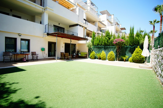Fantastic modern apartment with a huge 100 meter private terrace and garden. Located within a secure,Spain