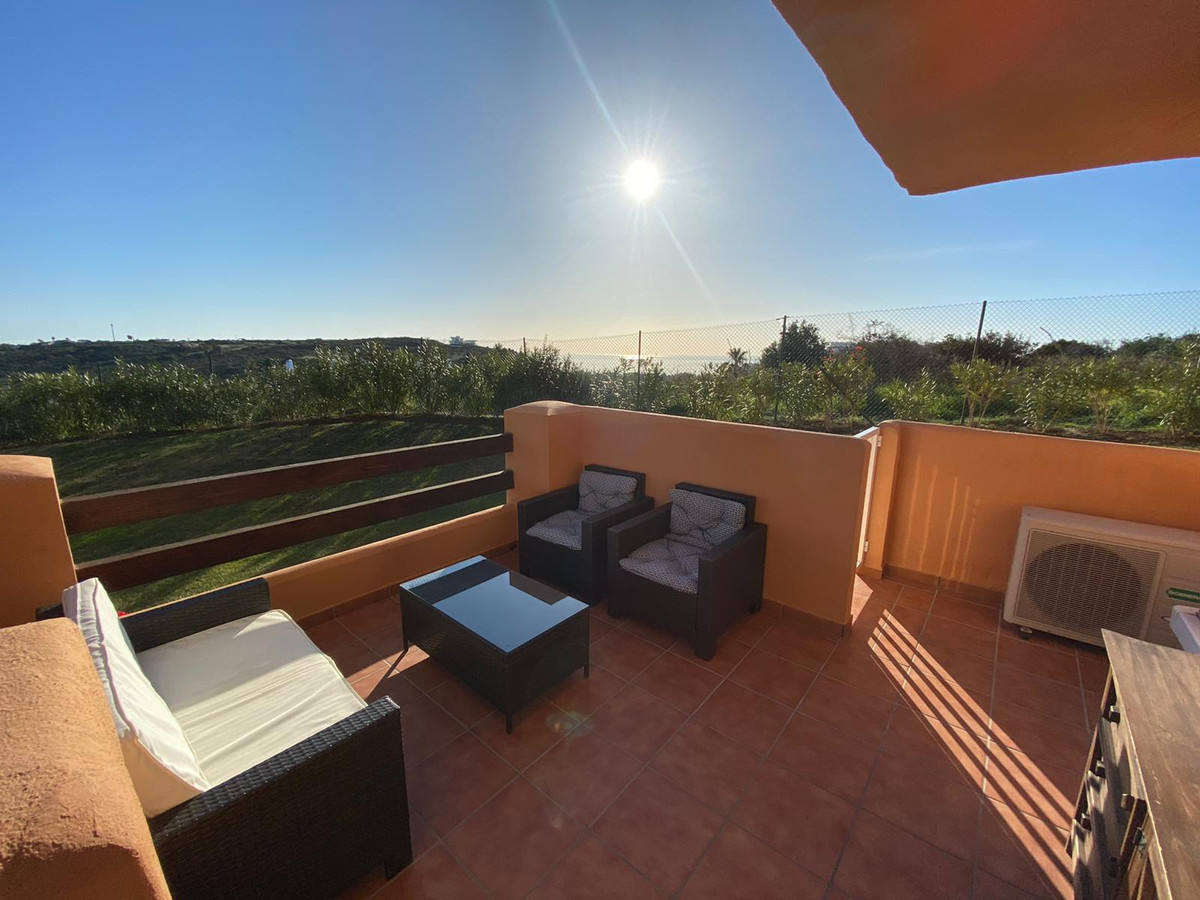 Amazing ground floor apartment with mountain, gardens and sea views. The apartment is set in a gated, Spain