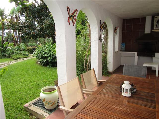 This rustic two bedroom two bathroom townhouse has both up and downstairs terraces which overlook th, Spain