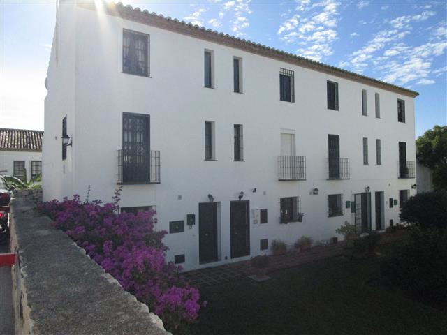 Rustic end of terrace townhouse set in the Andalucian style white washed urbanisation of Valle Verde,Spain
