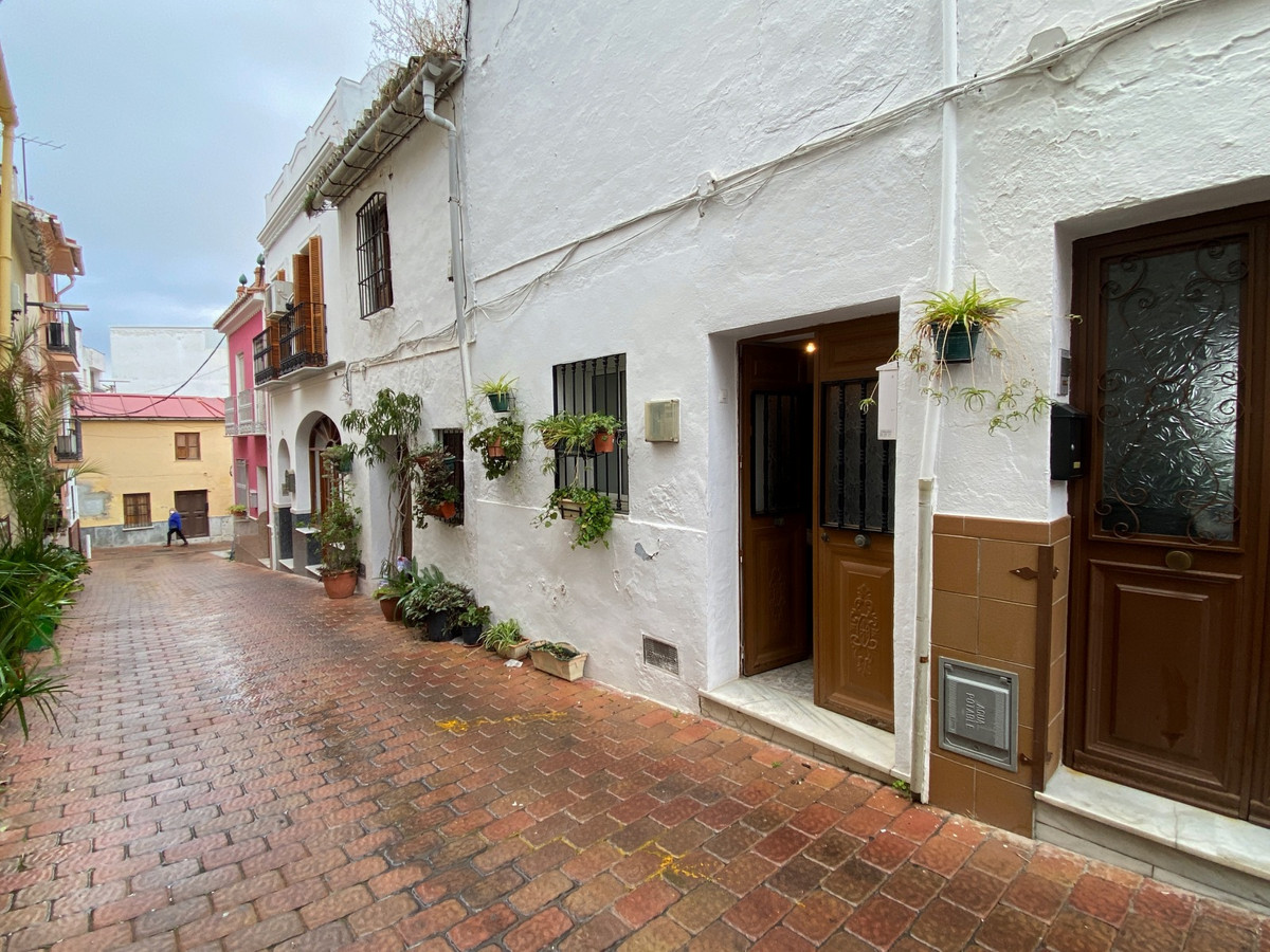 Town house in need of renovation in the centre of Coin in a pedestrian street.  This house is locate, Spain