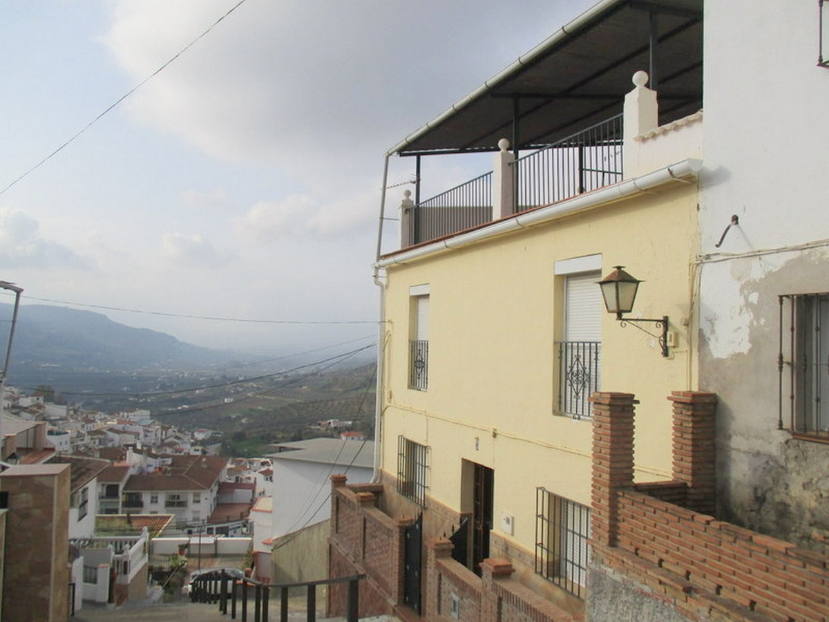 Attractive village house located in an elevated street in a prestigious zone of Alora pueblo.  The m, Spain