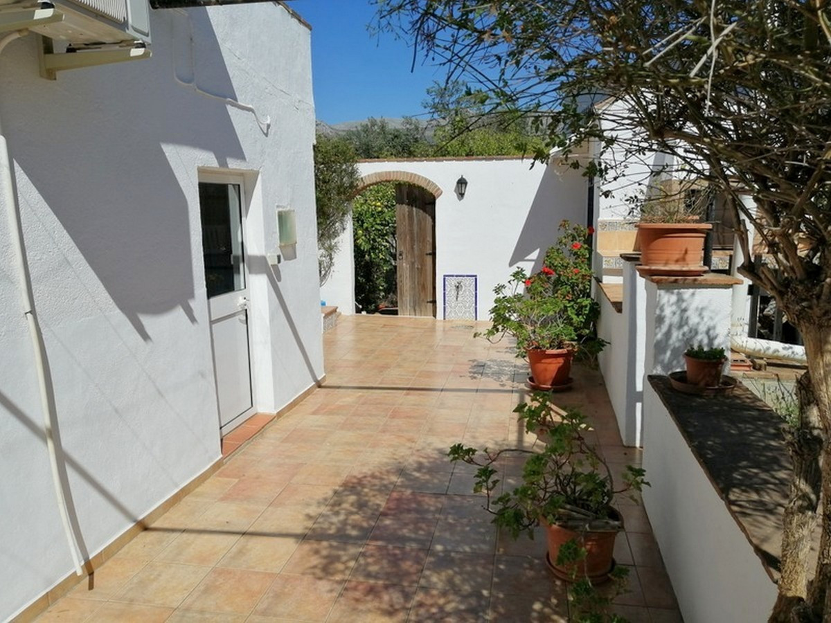 This very pretty immaculately presented villa enjoys a much sought after semi-rural location, on the, Spain