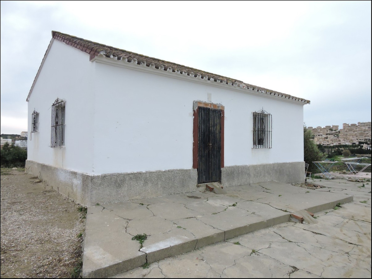 Large vineyard with small house that needs restoration.,Spain