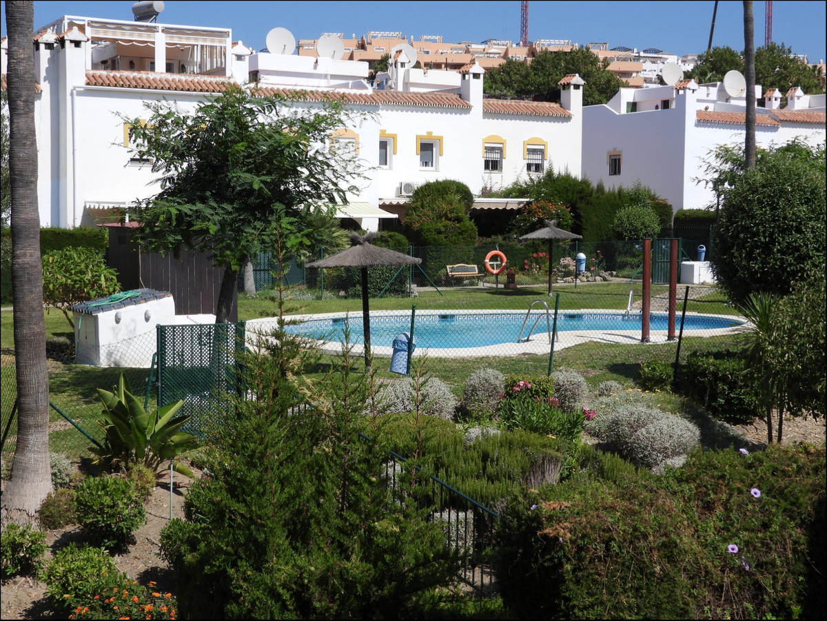 Corner townhouse in marina de casares, just on mountainside , no problems with costa. In good condit,Spain