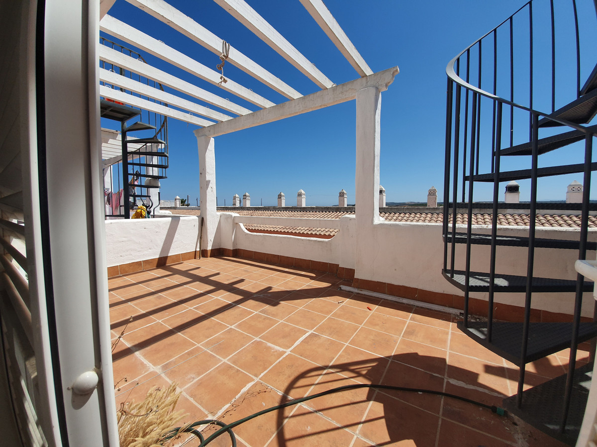 A townhouse in a gated community in the town of Manilva. This fantastic house is a gem within the to,Spain