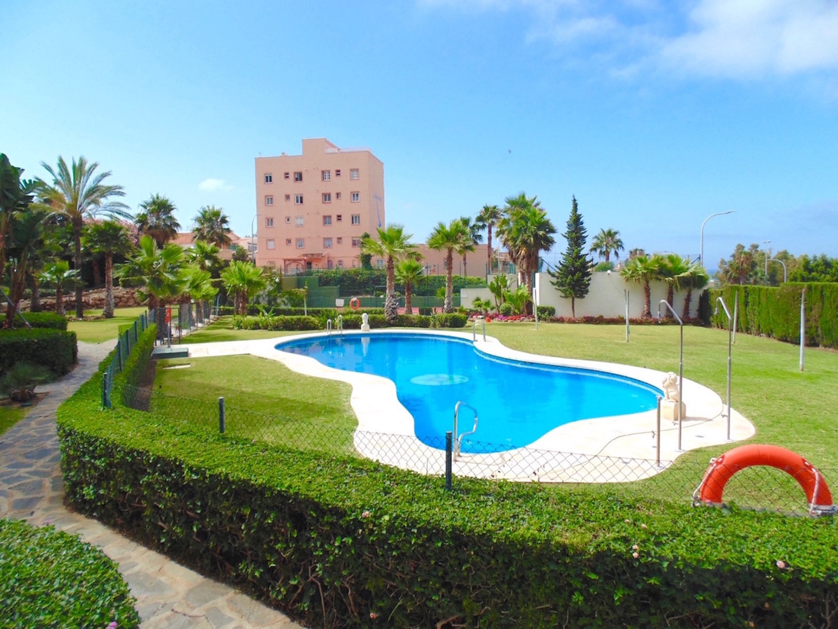 Just a 5 minute walk from the beautiful beaches of Torrequebrada, this ground floor apartment is sit, Spain