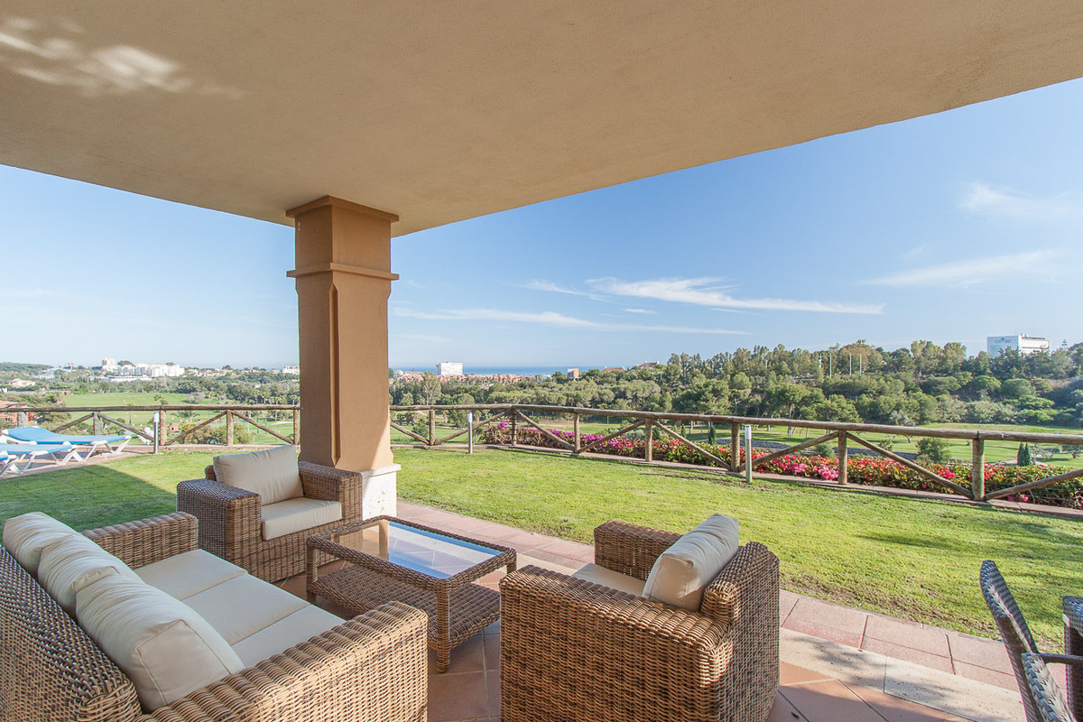 Lovely 3 bedroom semi-detached villa boasting beautiful sea and golf views with an extensive private, Spain