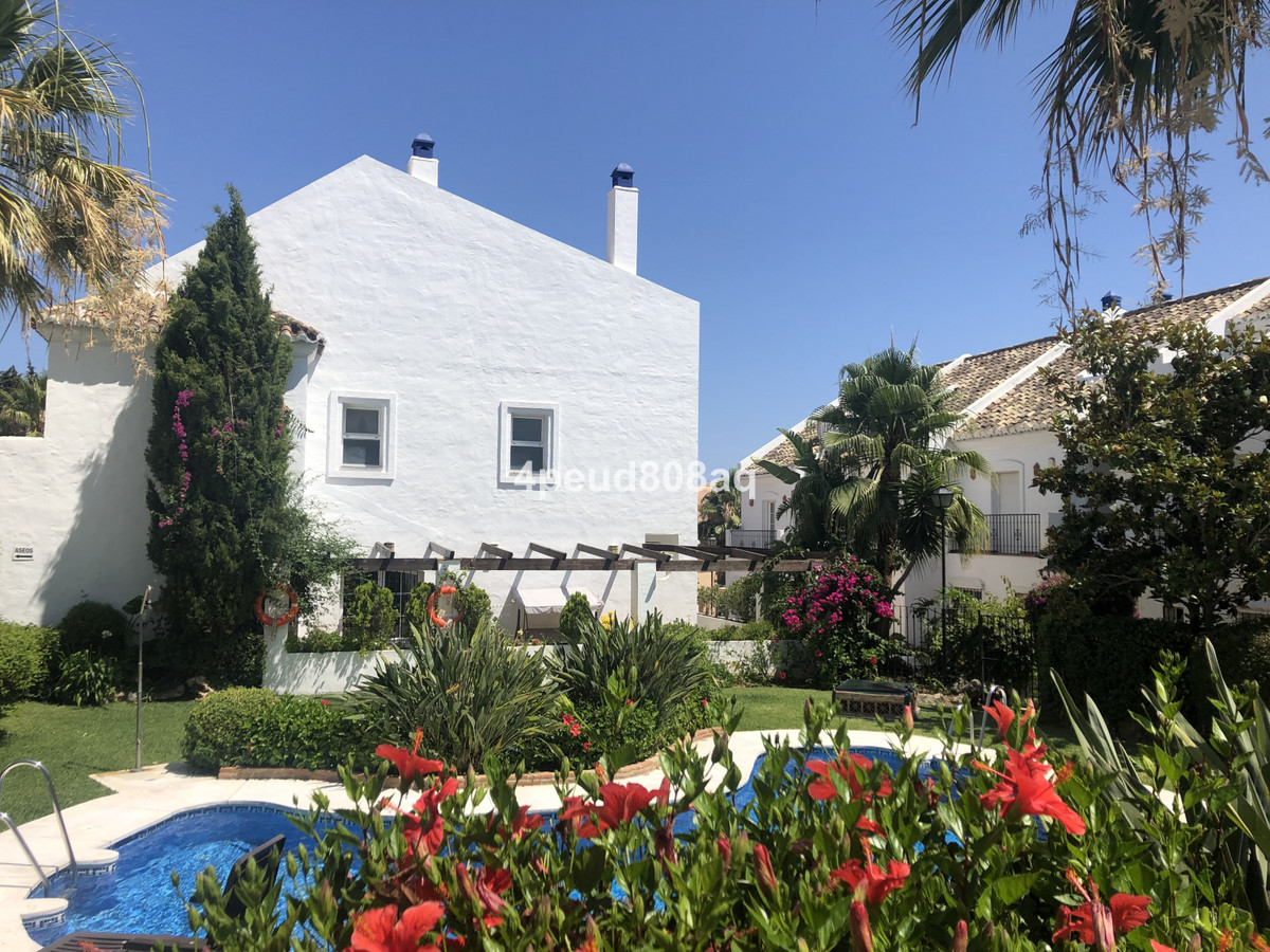 South facing corner townhouse distributed over 2 floors with underground two car private garage and ,Spain