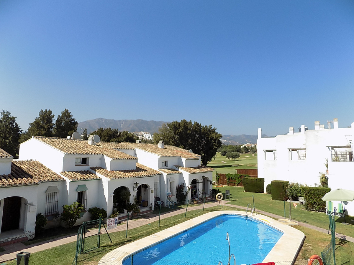 This is a lovely two bedroom townhouse set in a small friendly community on the front line of the Mi, Spain