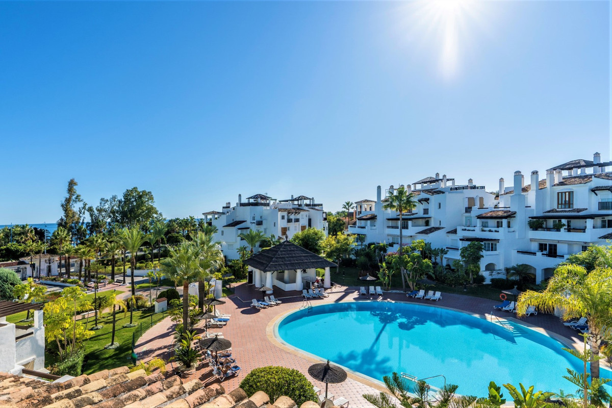 Charming Mediterranean architecture on the beachfront with extensive subtropical gardens and huge beSpain