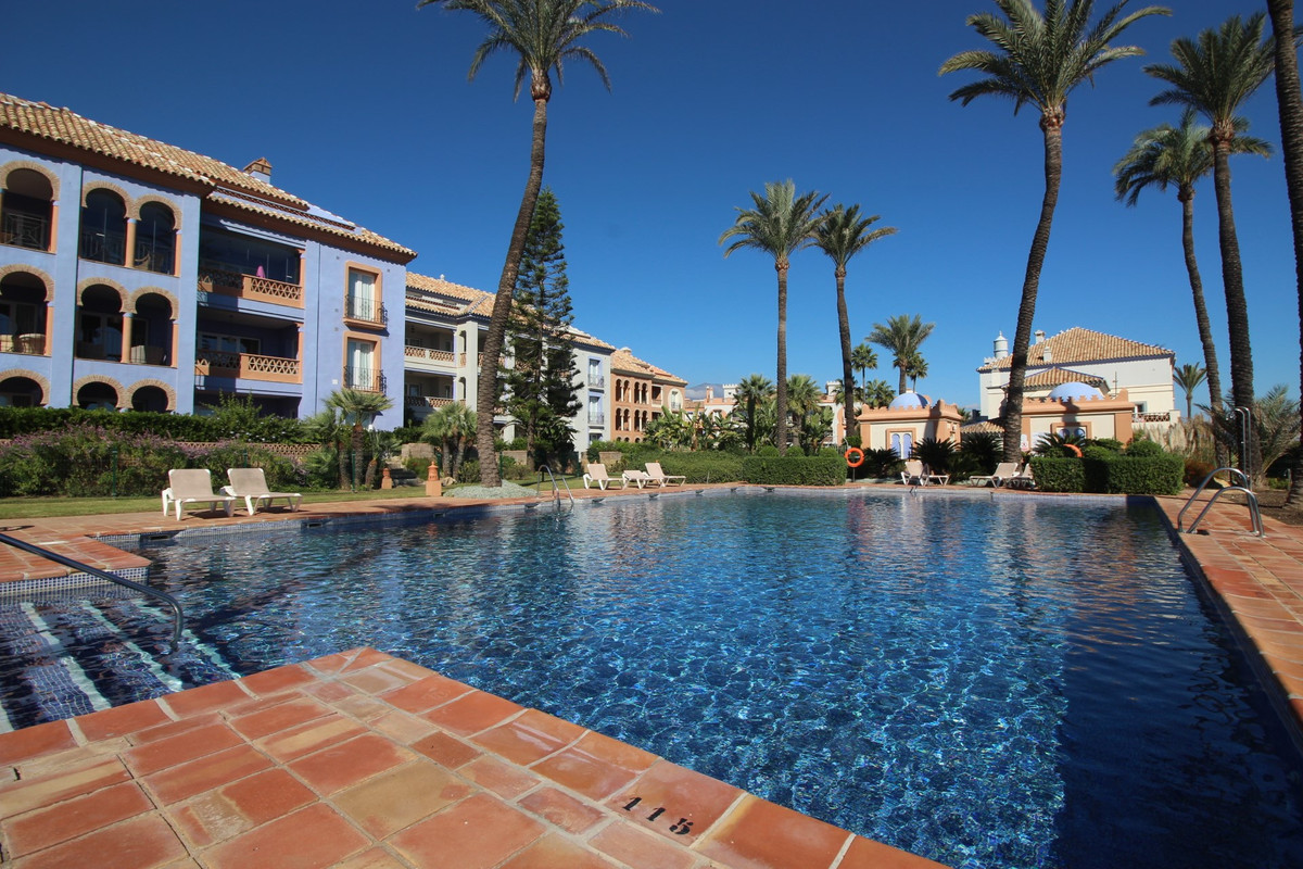 Ground floor apartment with large terrace situated in the beautiful La Perla de la Bahia. Just a min,Spain